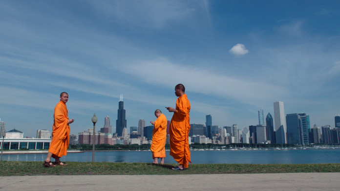 """A press shot from """"Lo and Behold"""" shows some monks texting"""
